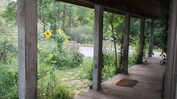 Historic Home Castle Chateau organic herb farm wood deck porch sunflowers echinacea covered deck front door